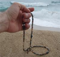 Ranka laiko maldos karolius